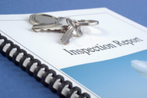 Brochure of Inspection Report, with keys on top.