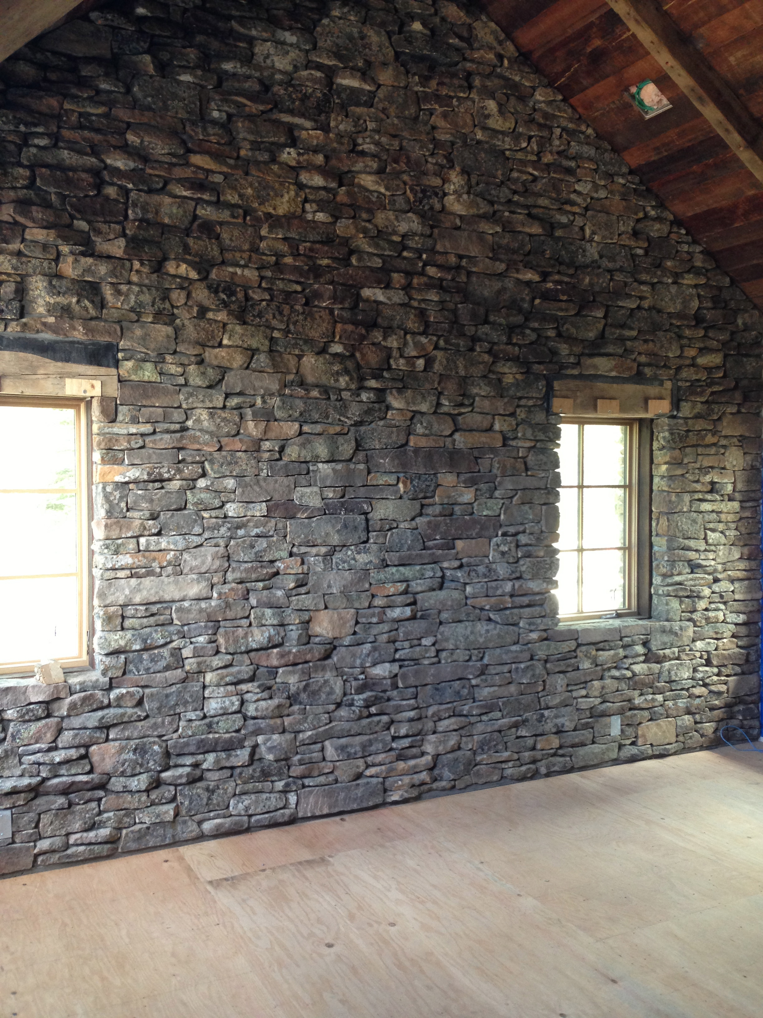 Wall with Radiant Heating Installed Under Stonework